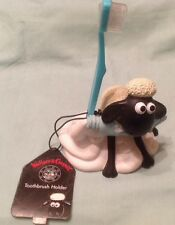 A Wallace and Gromit, 'Shaun the Sheep' Toothbrush Holder. With brush and tags.