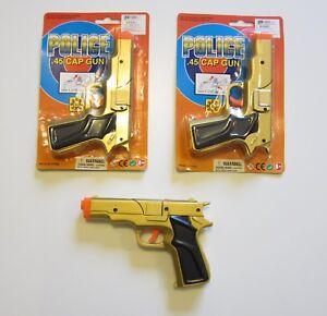 2-NEW-GOLD-TOY-CAP-GUNS-7-034-POLICE-GUN-45-DETECTIVE-PISTOL-FIRES-8-RING-CAPS