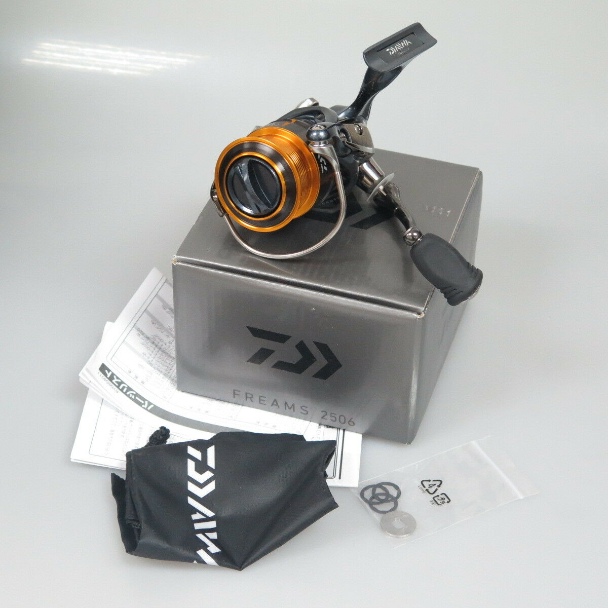 NEW DAIWA FREAMS 2506 Spinning Reel Mag Sealed FEDEX PRIORITY 2DAY TO US