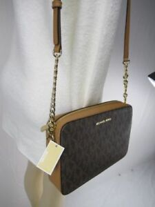 f7f8b24e8bd6 NWT MICHAEL KORS MK LOGO PVC JET SET LARGE EW CROSSBODY BAG IN BROWN ...