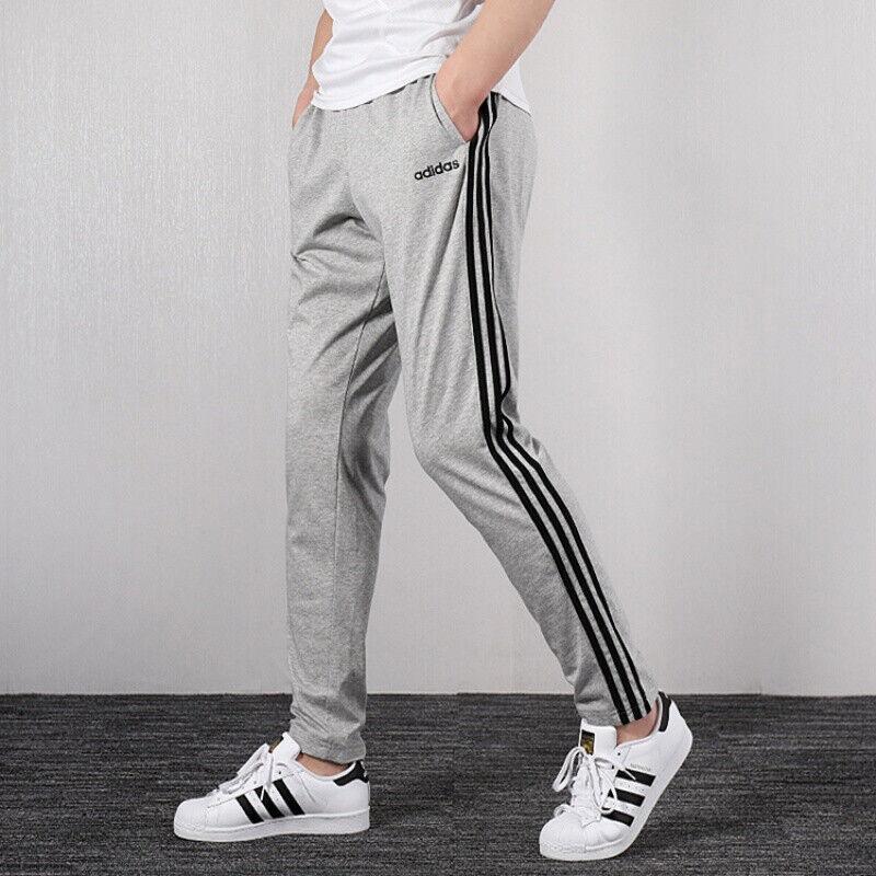 adidas Essentials 3 Stripe Tapered Open Hem Jersey Pants Legend ...