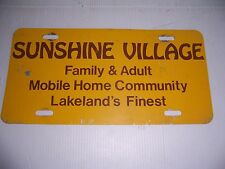 VINTAGE SUNSHINE VILLAGE FAMILY MOBILE HOME LAKELAND'S FINEST LICENSE PLATE