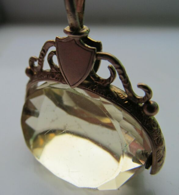 Antique 9 ct gold pocket watch fob, with heart decoration.