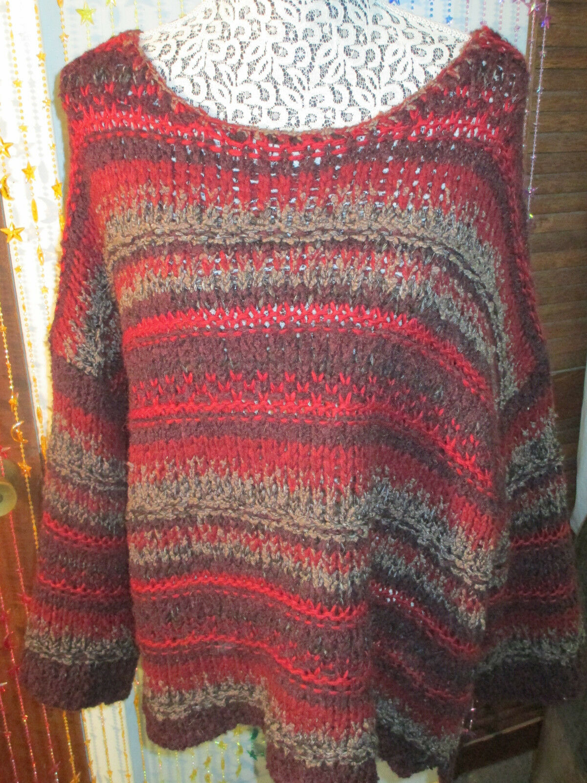 STRIKING COLORS Free People heavier sweater,size Lg.sells at  128.nwt