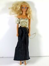 DRESSED BARBIE DOLL IN GOLD AND BLACK DRESS