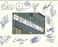 A 10 x 8 inch mount personally signed on 12.04.2012 by 13 of the Bury squad.