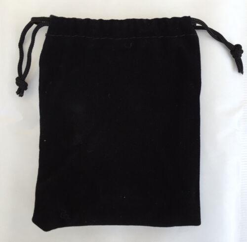Pochette velour noir étui bijoux montre collier bague
