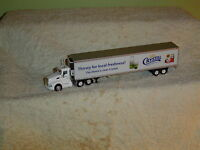 Tonkin 1/87th Kw T-660 Trac /trailer, Foster Dairy,crystal