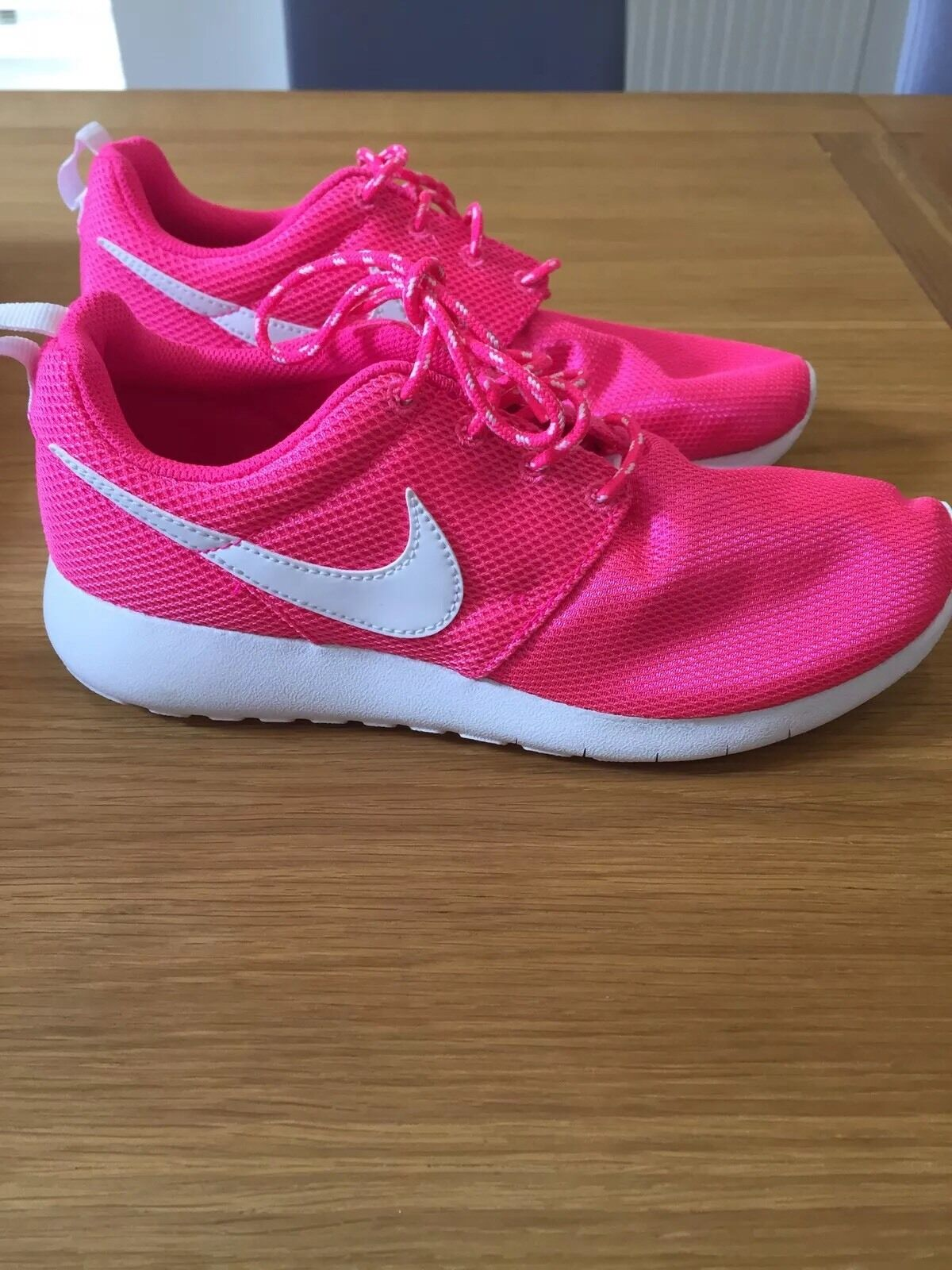 New in box Nike Roshe One new in pink size 4.5 or Genuine best-selling model of the brand