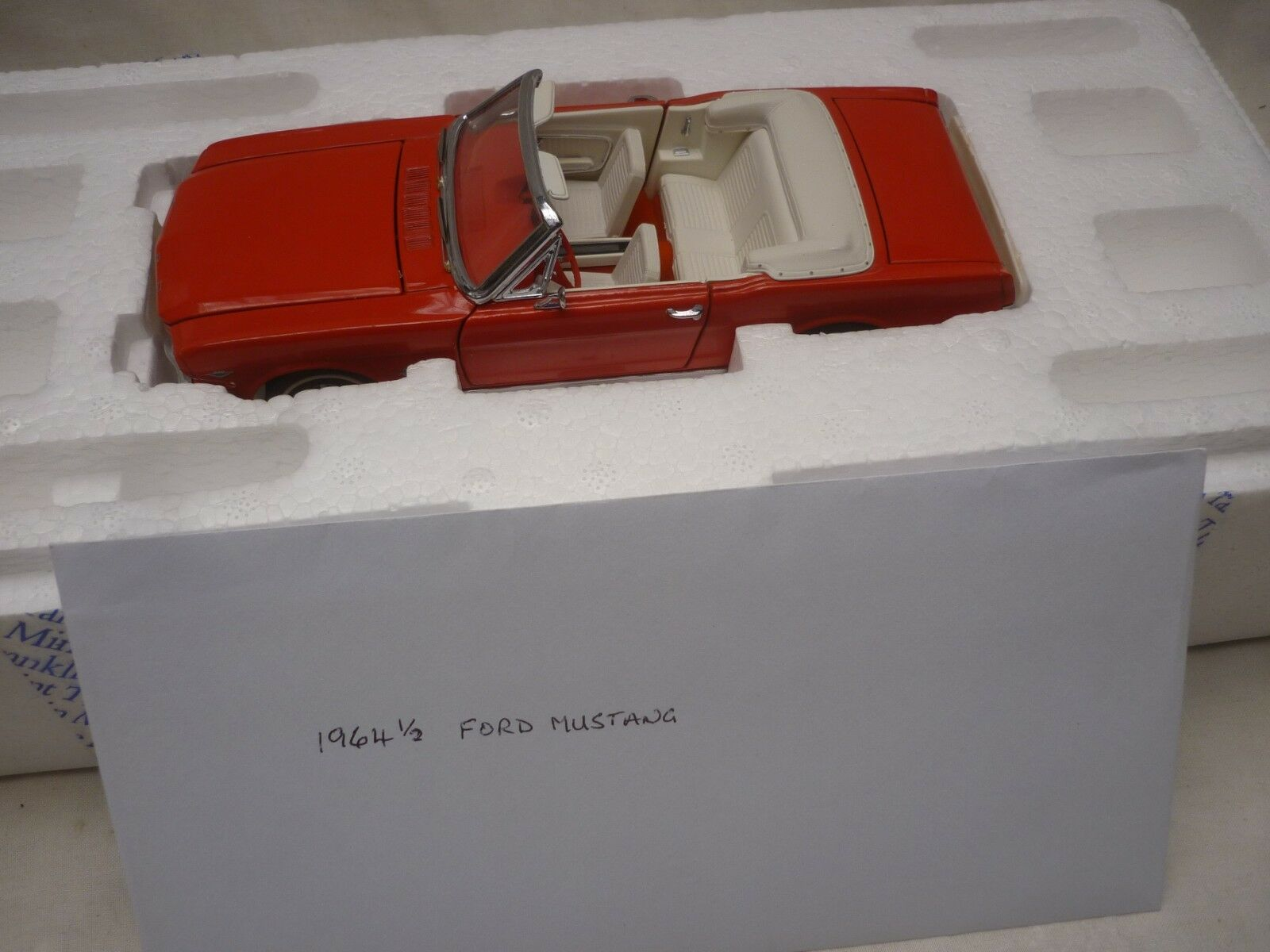 A Franklin mint 1964 Ford Mustang, rare colour.  boxed & paperwork
