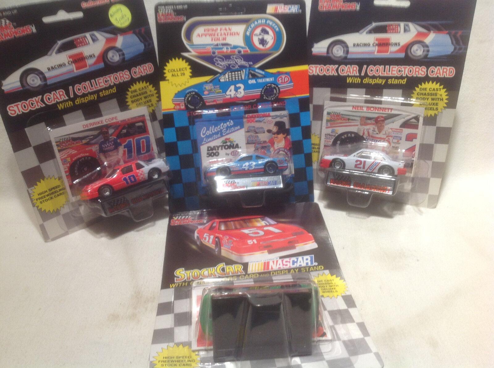 Racing Champions-Kyle Petty, Derrike Cope, Richard Petty, Neil Bonnet - 4 voitures - 1 64