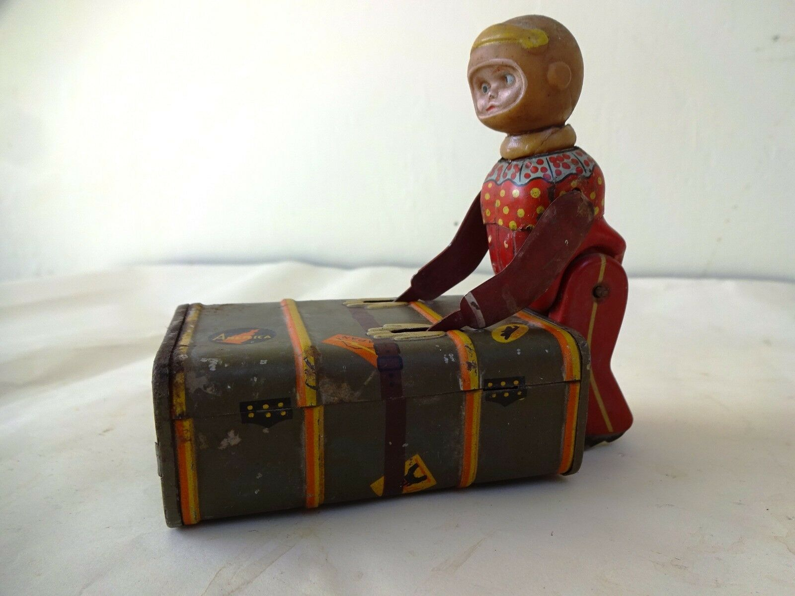 Antiguo Juguete De Hojalata Express Niño Equipaje Porter mecánico hecha en japón de colección
