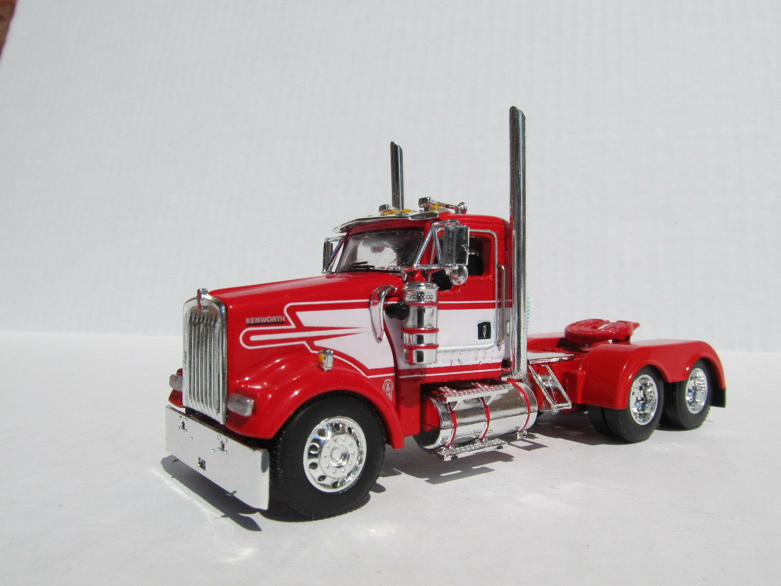 DCP 1 64 SCALE W-900 KENWORTH DAY CAB RED WITH WHITE STRIPE - TRACTOR ONLY