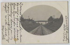 1906-Larville-Indiana-Bridge-across-Railroad-tracks-Real-Photo-Postcard-RPPC
