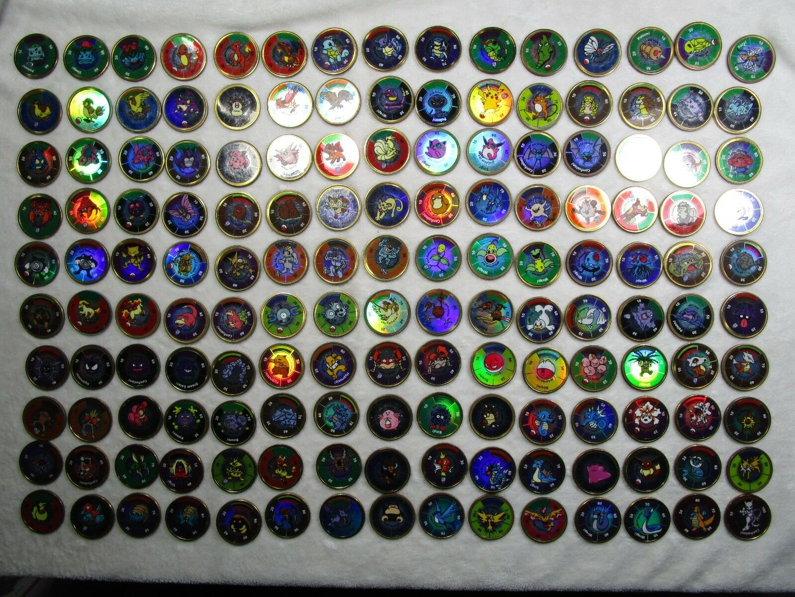 COMPLETE Pokedex Lot of 150 Pokemon Battling coins. With Charizard and more
