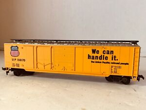 HO-Railroad-Freight-Train-Yellow-Box-Car-Union-Pacific-We-Can-Handle-It-Vintage
