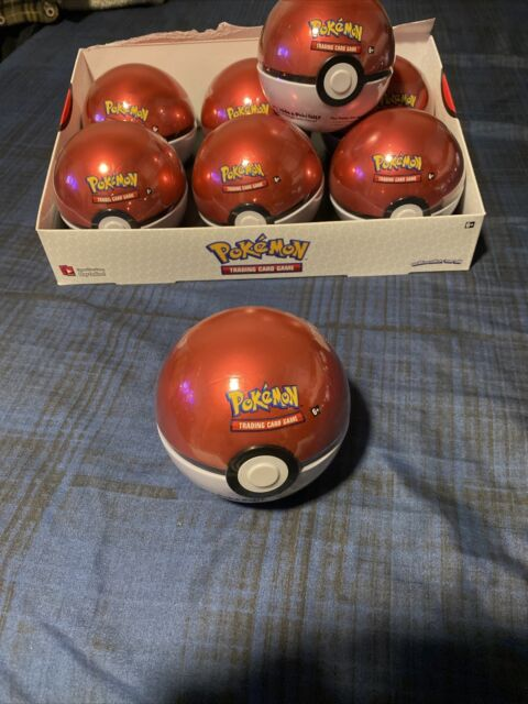 - Tracked P/&P 2019 Pokeball Tin includes 3 boosters /& 1 coin Pokemon