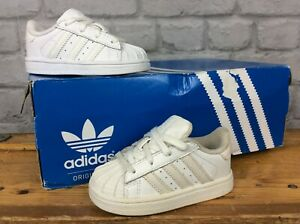 sports shoes fc7fe c3cd6 Details about ADIDAS UK 4 EU 20 ALL WHITE SUPERSTAR BABY BOYS GIRLS  CHILDREN TRAINERS