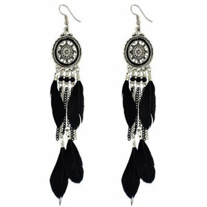 Silver-Oval-Earrings-with-Feather-Tassels