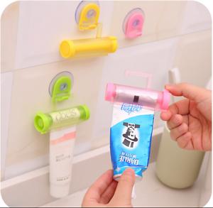 Plastic-Rolling-Toothpaste-Tube-Squeezer-Dispenser-Holder-Sucker-Hanging-Cute-d6