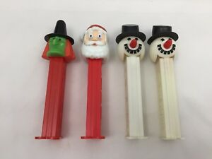 4-VINTAGE-PEZ-DISPENSERS-HOLIDAY-THEMED-GREEN-WITCH-SANTA-CLAUSE-PAIR-SNOWMEN