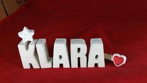 Beton-Steinguss-Buchstaben-3D-Deko-Namen-KLARA-als-Geschenk-verpackt