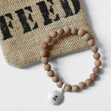 FEED 5 Bracelet and a pouch. Benefits United Nations World Food Programme