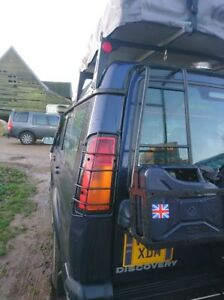 LANDROVER DISCOVERY  SERIES II TD5 CAMEL TROPHY REAR LIGHT GUARDS 98-04