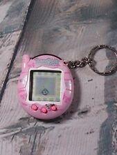 Tamagotchi Connection - Electronic Virtual Pet - Bandai 2004 - Pink/Ribbons