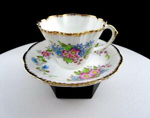 SALISBURRY ENGLAND #1899 PINK AND BLUE FLORAL 2 1/2 CUP AND SAUCER