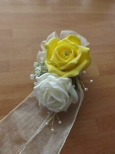 Wedding-flowers-bridesmaids-wrist-corsage-ivory-yellow-roses-diamante-pearls