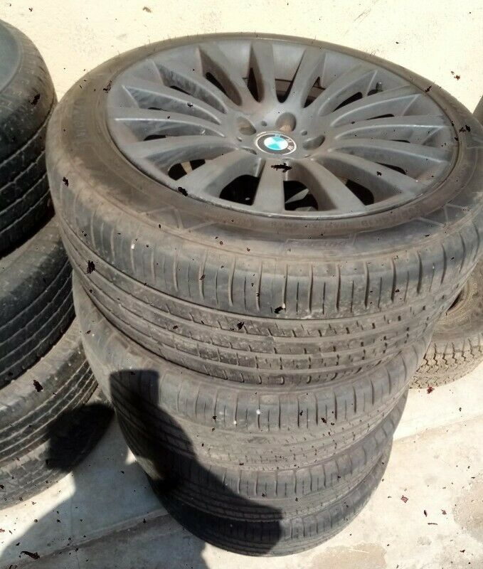 "19"" BMW mags with used 255/45/19 80% treads set for R6000."