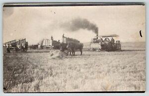 Victoria-KS-Newlywed-Albert-Devore-Runs-Engine-Thrasher-Bundles-Grain-RPPC-1914