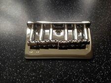 Hardtail solid rod saddle skeletal chrome guitar bridge . String thru back