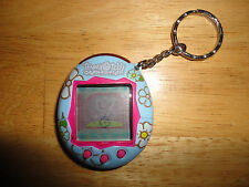 2004 BanDai TAMAGOTCHI CONNECTION Virtual Pet Keychain - Light Blue with Flowers