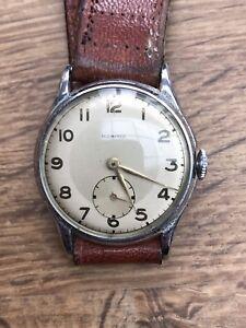 ancienne montre mécanique homme