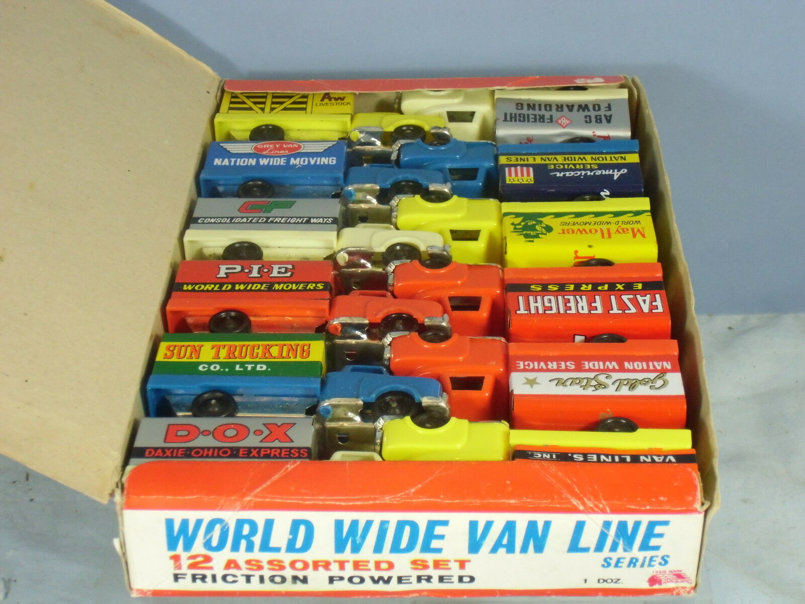 VINTAGE  TRADE BOX OF  ASSORTED FRICTION DRIVEN  MODEL VANS