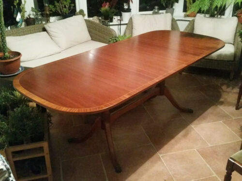 Long Georgian style extendable mahogany dining table. Very good condition.