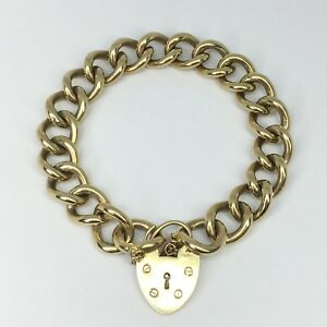 eb2d840cdbb64 Details about 9ct Gold Charm Bracelet with Heart Padlock - 10.5 Inches -  REF229