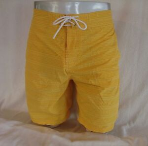 a9764b267f2b5 LACOSTE Yellow Allover Signature Logo Nylon Men s Swim Trunks Shorts ...