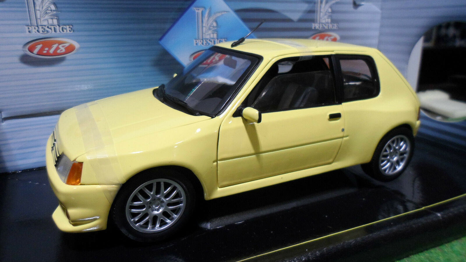 PEUGEOT  205 GTI TUNING 1990 amarillo 1 18 SOLIDO 8154 voiture miniature collection