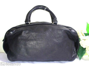 986e6ba79960 Image is loading Chanel-Black-Quilted-Leather-Barrel-Duffel-Travel-Hand-
