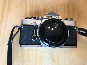 Olympus-OM-1-35mm-film-camera-silver-body-only