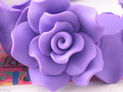 2 centrali rose rosa in gomma acrilica dura  30x15 mm
