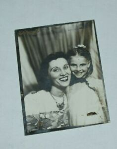 arcade passport vintage vernacular photography 1950s photo booth portrait tiny black and white photo of a blurred teenage girl