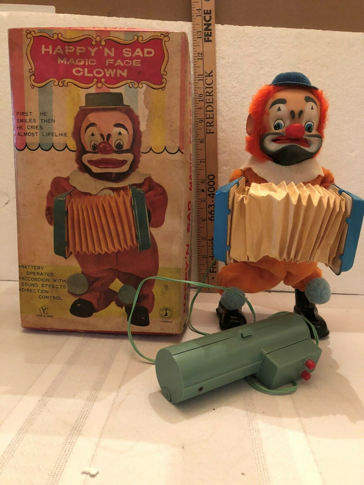 Battery operated happy n sad face clown