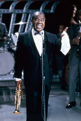 LOUIS ARMSTRONG HOLDING TRUMPET COLOR 24X36 POSTER