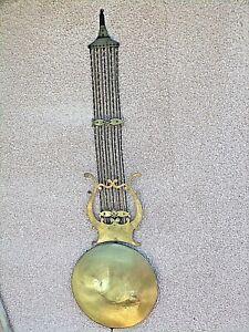 Ancien-balancier-lyre-d-039-horloge-en-cuivre-repousse-grosse-lentille-Napoleon-III
