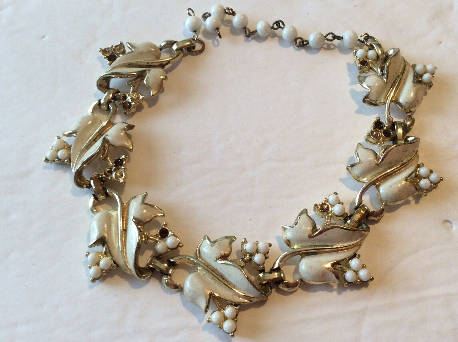 Ivory Enamel Collectible Designer Vintage 50s Signed Coro White Enamel Leaf Bead Cluster Necklace and Clip On Earrings Set Gold Tone