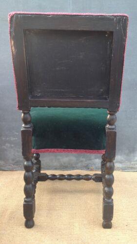 Traditional vintage oak chair reupholstered in green velvet